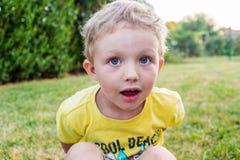 Dirty little boy is making a break Royalty Free Stock Photos