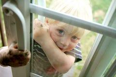 Dirty Little Boy Peeking in Window stock images
