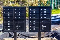 Dirty Mailboxes For New Construction Homes. New Dirty Black Mailboxes For New Homes Under Construction Royalty Free Stock Photo