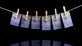 Dirty Malaysia Ringgit banknotes hanging from a clothesline. And reflecting in the glass stock video