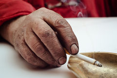 Dirty hand with cigarette Stock Images