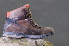 Dirty male shoes. Dirty worn male winter shoes on stone Royalty Free Stock Photos