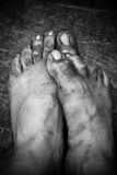 Dirty male worker foots Stock Photos