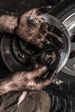 Dirty man hand with gear Royalty Free Stock Photo