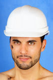 Dirty manual worker with hard hat Royalty Free Stock Images