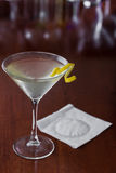 Dirty martini with a lemon twist Royalty Free Stock Photos