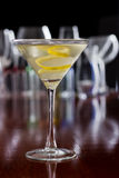Dirty martini with a lemon twist Royalty Free Stock Images