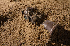 Dirty mask. Vintage mask burried in sand royalty free stock image