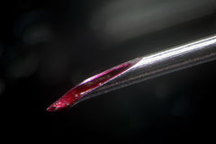 Dirty medical needle tip. Blood in canal not sterile used syringe. Unsanitary injections and infection risk. Morphinism drug. Used medical needle tip with bloody stock photography