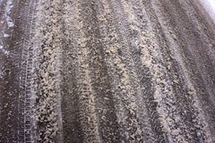 Dirty melted snow and slush on the asphalt road in the winter season. photo close-up with a shallow depth of field stock image