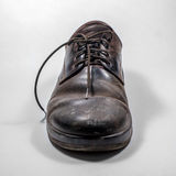 Dirty men's shoes sprinkled with whitewash. Royalty Free Stock Photos