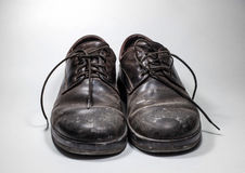 Dirty men's shoes sprinkled with whitewash. Stock Photos