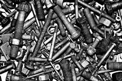 Dirty metal nuts and bolts. Royalty Free Stock Image