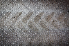 Dirty metal pattern and tyre tracks Stock Images