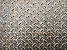 Dirty metallic surface with diamond plate pattern Stock Image