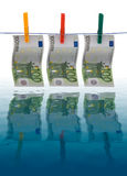 Dirty money. Picture showing money laundering concept - 100 euros banknotes drying on a clothes line Royalty Free Stock Photos