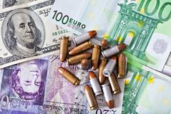Dirty money concept with bullets Royalty Free Stock Photos