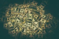 Dirty Money Concept Photo. Pile of American Dollars Cash Money on the Ground royalty free stock photos