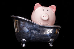 Dirty money piggy bank Stock Images