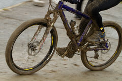 Dirty Montainbiker. Dirty mountainbike with a lot of mud Royalty Free Stock Photo
