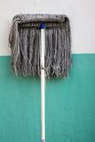 Dirty mop. On wall background Stock Images