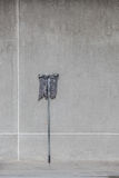 A dirty mop leaned on the cement wall Stock Photography