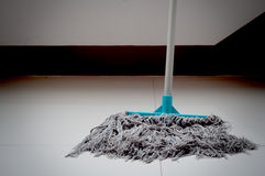 Dirty mop and white floor Stock Photography
