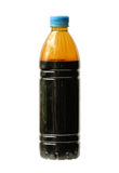 Dirty motor oil in bottle. Isolated on white background Stock Photo