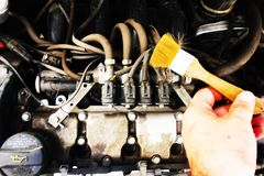 Dirty motor vehicle with brush. Cleaning dirty motor vehicle with brush Stock Image