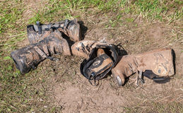 Dirty motorcycle boots after the competition in motocross Royalty Free Stock Photos