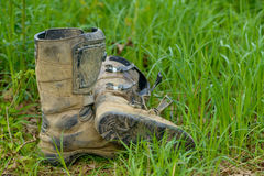 Dirty motorcycle boots Royalty Free Stock Photography