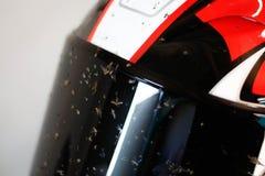 Dirty motorcycle helmet. Helmet in dead flies. Helmet after the race.  royalty free stock image