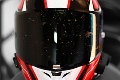 Dirty motorcycle helmet. Helmet in dead flies. Helmet after the race.  stock photo