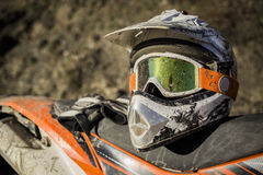 Dirty motorcycle motocross helmet with goggles. Offroad adventure motorcycle enduro trip protection helm glasses Stock Photography