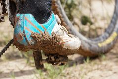Dirty mountain bike covered with mud and dirt stock image