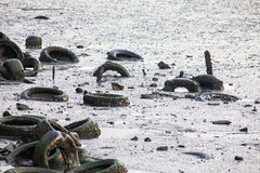 Dirty muddy beach showing a dump site Stock Photography