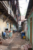 Dirty narrow backyard. Backyard exterior. Kochi (Cochin), Kerala, India Royalty Free Stock Photo