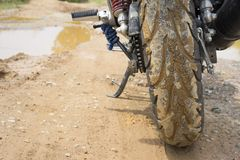 Dirty off-road tire after passing a mud terrain area.  Stock Photos