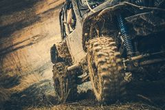 Dirty Off Road Trail Drive. Powerful Sport Utility Vehicle in the Mud. Motorsport Theme stock photography