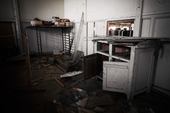 Dirty office furniture in an abandoned factory Royalty Free Stock Photo