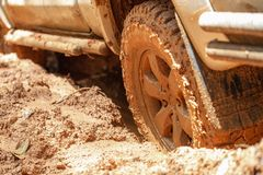 Dirty offroad car, SUV covered with mud on countryside road, Off-road tires, offroad travel and driving concept stock photos