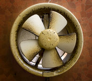 Dirty oil stained exhaust fan. Dirty oil stained kitchen exhaust fan on a mosaic wall Royalty Free Stock Photography