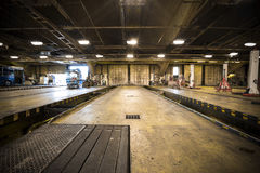 Dirty, oily bus garage inspection pit Stock Images