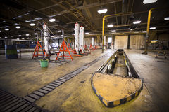 Dirty, oily bus garage inspection pit Stock Photo