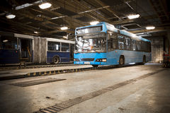 Dirty, oily bus garage inspection pit Stock Photos
