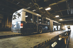 Dirty, oily bus garage inspection pit Royalty Free Stock Image