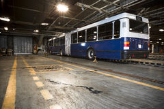 Dirty, oily bus garage inspection pit Stock Image