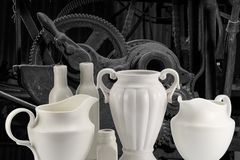 White porcelain jugs and bottles on the background of machine me royalty free stock photos