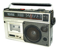 Dirty old 1980s style cassette player. Radio against a white background stock photography