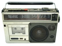 Dirty old 1980s style cassette player. Radio against a white background royalty free stock photo